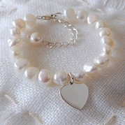 Child's Extending White Pearl Bracelet With Flat Heart Charm