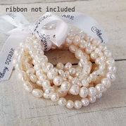 Set Of Eight Stretch White Pearl Bracelets (Assorted Designs)