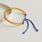Gold Cuff Bangle with Blue Cord
